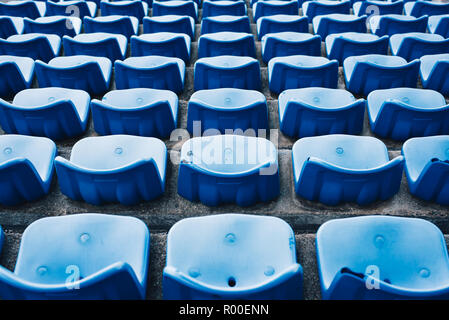empty blue colored stadium seats. Abstract and Sport concept - Stock Image