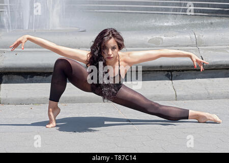 A beautiful young lady studying ballet in New York poses for a photo in Washington Square Park. - Stock Image
