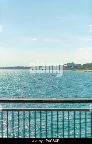 Bournemouth, UK. 22nd June 2018. UK sunny weather, a view over the pier in oscombe beach towards Bournemouth. Thomas Faull/Alamy Live News - Stock Image