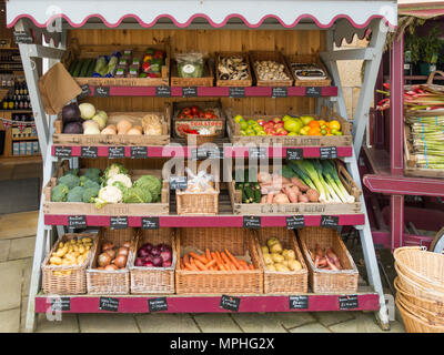 An attractive display of spring fruit and vegetables with 2018 price tickets in a greengrocer's shop in Castle Howard North Yorkshire - Stock Image