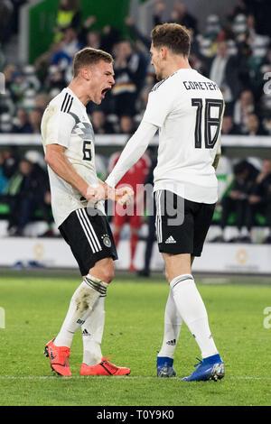 Wolfsburg, Deutschland. 21st Mar, 2019. Joshua KIMMICH (left, GER) and goalkeeper Leon GORETZKA (GER) cheer about the goal to make it 1-1 for Germany, jubilation, cheer, cheering, joy, cheers, celebrate, goaljubel, full figure, portrait, football Laenderpiel, friendly match, Germany (GER) - Serbia (SRB) 1: 1, on 20.03.2019 in Wolfsburg/Germany. ¬ | usage worldwide Credit: dpa/Alamy Live News - Stock Image