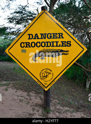 Warning sign at  the iSimangaliso Wetland St Lucia ,  home to possibly the largest population of Nile Crocodiles - Stock Image
