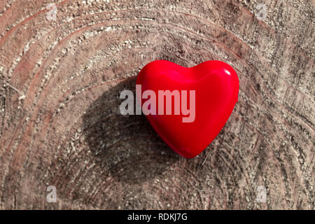 Red heart on a wooden background. - Stock Image