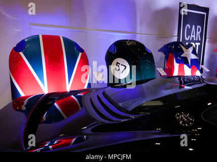 View of the carART stand at the 2018 London Motor Show. Custom Painted bonnets  are reflected in the rear of a Jaguar XJ 220 - Stock Image