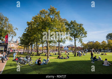 People relaxing at Museumsplain on sunny day in Amasterdam - Stock Image