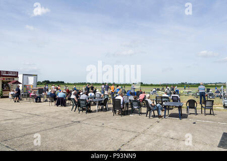 Crowd resting watching display at Wings and Wheels - Stock Image