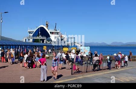 Busy ferry terminal as people await the boarding of the Calmac ferry from Craignure to Oban - Stock Image