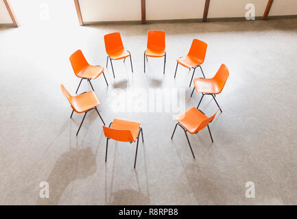 Circle of chairs ready in community center - Stock Image