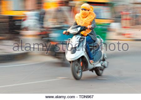 Woman on Scooter, Jodhpur, Rajasthan, India - Stock Image