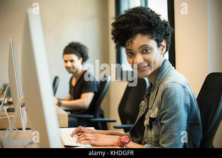 Woman working in office - Stock Image