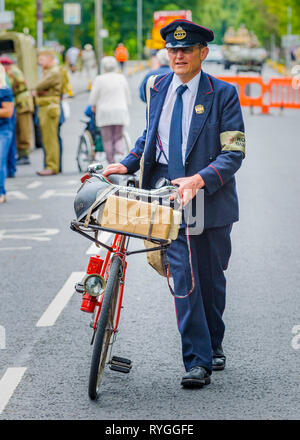 Woodhall Spa 1940s Festival - a 1940s postman with bicycle - Stock Image