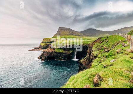 Gasadalur waterfall, Faroe Islands, landscape. Wild europe - Stock Image