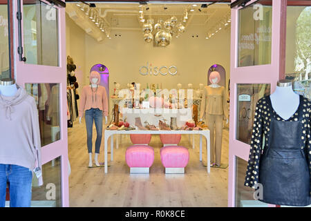 Disco, a young woman's clothing boutique clothing and accessory store in fashionable resort town of Rosemary Beach Florida USA. - Stock Image