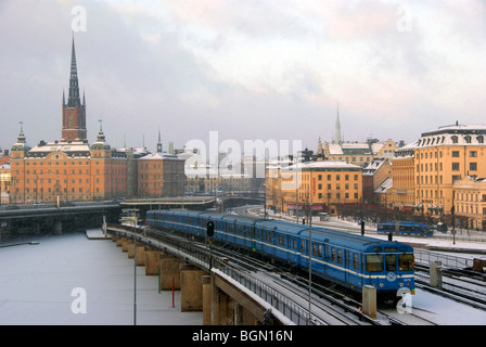 Stockholm Sweden winter. Moving train during snowfall - Stock Image