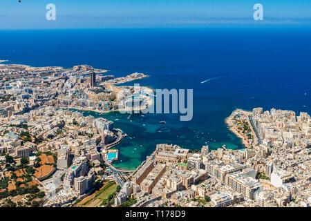 Malta aerial view. St. Julian's (San Ġiljan) and Tas-Sliema cities. St. Julian's bay, Balluta bay, Spinola bay. Towns, harbours and coastline of Malta. - Stock Image