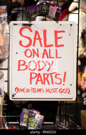 A ghoulish sign for sale at the Halloween Adventure costume store on Broadway in Greenwich Village, New York City. - Stock Image