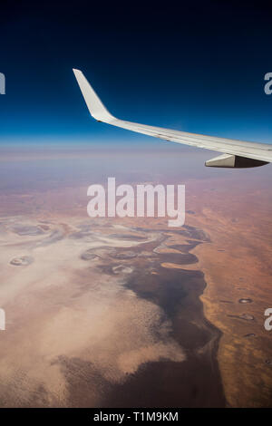Aerial view airplane wing over landscape - Stock Image