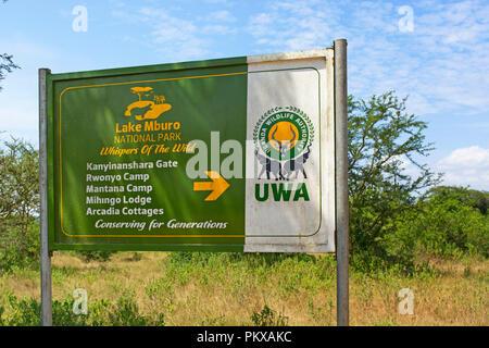 Sign, Lake Mburo National Park with Directions to Kwaninyanshara Gate, Rwonyo Camp, Mantana Camp, Mihingo Lodge & Arcadia Cottages, Uganda East Africa - Stock Image