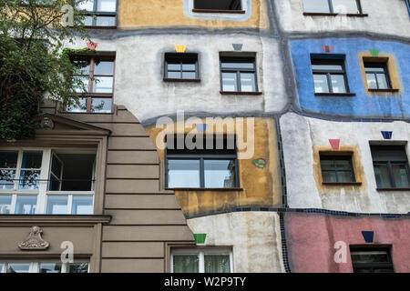 Hundertwasserhaus, designed by architect Friedensreich Hundertwasser (a pseudonym), a local landmark and tourist attraction, Vienna, Austria. - Stock Image