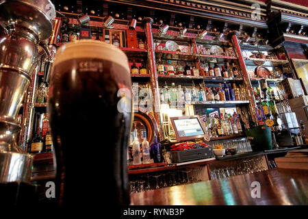 pint of beamish stout in The Long Hall victorian pub one of the oldest pubs in Dublin republic of Ireland - Stock Image