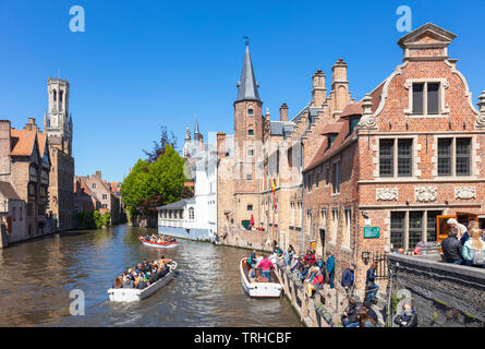 Iconic view Tourists in boats for boat trips leaving from the Rozenhoedkaai Rozenhoedkai Quay of the Rosary Den Dijver canal Bruges Belgium EU Europe - Stock Image