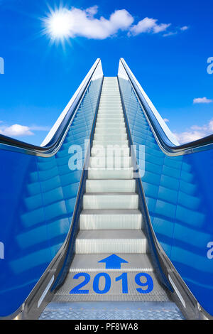 Reaching the new year 2019 on a moving stairway or escalator into a clear blue sky. Concept photo for success and reaching goals on a smooth and easy  - Stock Image