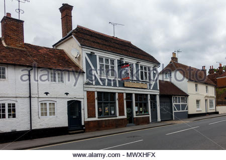 The exterior of the Plough Inn a public house in the High Street, Farnham, Surrey UK - Stock Image