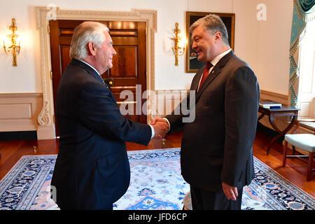 U.S. Secretary of State Rex Tillerson greets Ukrainian President Petro Poroshenko before their bilateral meeting - Stock Image