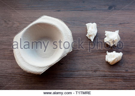 Cardboard sick bowl with tissues - Stock Image