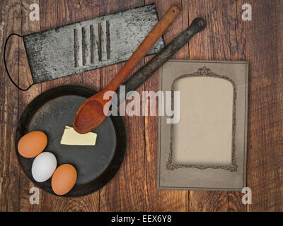 vintage utensils set, skillet,spoon,grater, eggs,butter, space for your text on a blank menu card - Stock Image