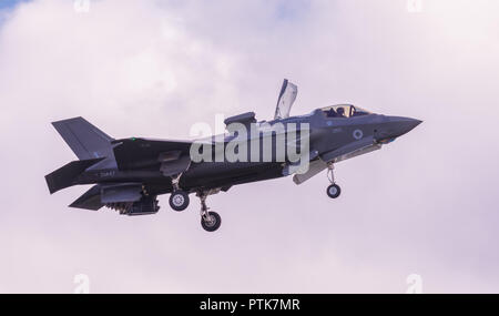A British Lockheed Martin F-35 B Lightning II 5th generation multirole stealth fighter hovering on display flight at Duxford Air Show. - Stock Image