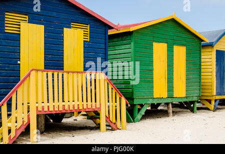 The back sides of a series of beach huts at St. James Beach near Capetown, South Africa. - Stock Image