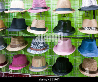 Trilby hats for sale at a market - Stock Image