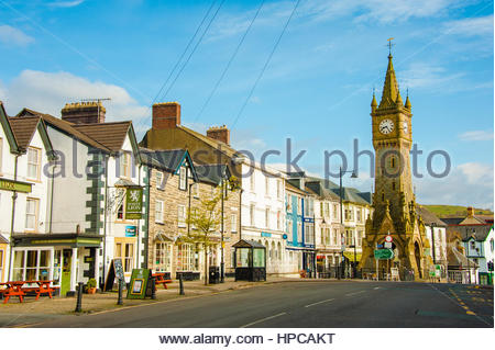 Machynlleth Clock Tower on the High Street. Early morning sunshine in the mid Wales Market Town in the county of - Stock Image