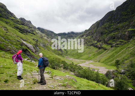 View up the Lost Valley or Coire Gabhail with hikers on path from Glen Coe pass. Glencoe, Lachabar, Inverness-shire, Highland, Scotland, UK, Britain - Stock Image