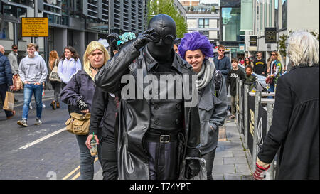 Brighton UK 4th May 2019 - Colourful fashion for visitors as they enjoy the sunny but cool weather in Brighton today with unsettled conditions forecast for the UK over the next few days. Credit: Simon Dack / Alamy Live News - Stock Image