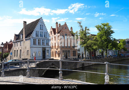Scenic city view of Bruges canal with beautiful medieval colored houses and reflections. - Stock Image