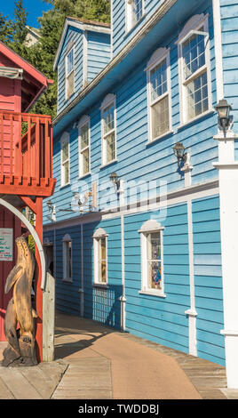 Sept. 17, 2018 - Ketchikan, AK: Narrow alley between colorful wooden buildings on former red light district of historic Creek Street, a popular touris - Stock Image