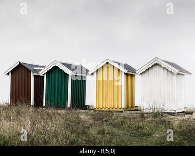 Wooden huts against overcast sky - Stock Image