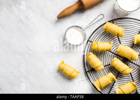 Making french pastry croissants or rolls. - Stock Image