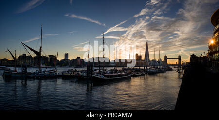 London, England UK. Tower Bridge and The Shard and River Thames with Thames Barges at Sunset dusk. 27 Sept 2018 - Stock Image