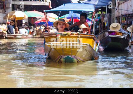 Damnoen Saduak, Thailand - August 29, 2018: Tourists on a Boat in Damnoen Saduak Floating Market, Ratchaburi, Thailand. - Stock Image