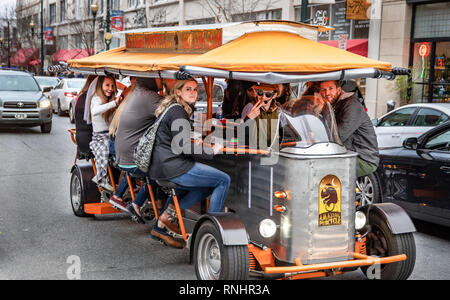 ASHEVILLE, NC, USA-2/16/19: A 13 seater pedal-powered touring vehicle transports tourists around town, with stops at pubs en route. - Stock Image