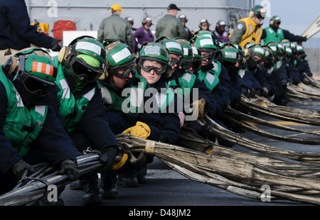 USS Nimitz conducts a barricade drill. - Stock Image