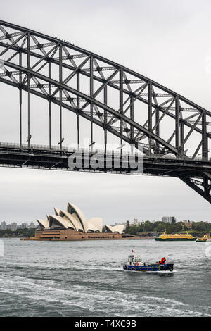 Sydney Harbour Bridge carries car, train, bicycle and pedestrian traffic between Sydney Central Business District (CBD) and the North Shore. - Stock Image