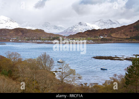 Shieldaig village from across Loch Shieldaig with the Torridon mountains of Beinn Alligin and Liathach, Wester Ross, Northwest Highlands, Scotland - Stock Image