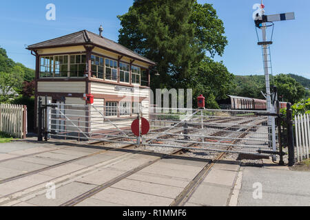 The signal box and level crossing at Glyndyfrdwy now preserved by the volunteer run Llangollen heritage steam railway in North Wales - Stock Image