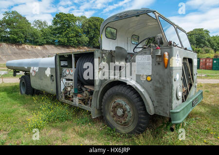 WEYBRIDGE, SURREY, UK - AUGUST 9, 2015: Vintage Airport Tug vehical on display at Brooklands Motor Museum in August - Stock Image