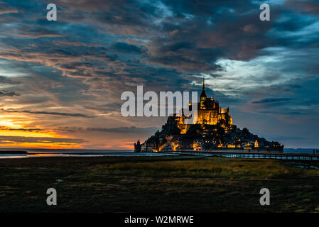 Dramatic sunset on Mont Saint Michel, Normandy, France - Stock Image