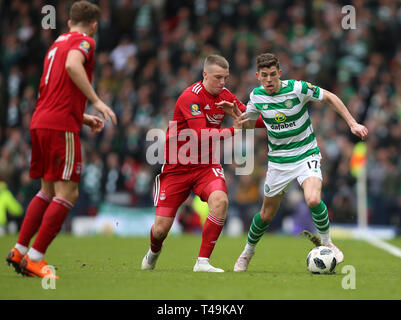 Hampden Park, Glasgow, UK. 14th Apr, 2019. Scottish Cup football, semi final, Aberdeen versus Celtic; Ryan Christie of Celtic shields the ball from Lewis Ferguson of Aberdeen Credit: Action Plus Sports/Alamy Live News - Stock Image